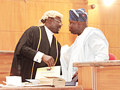 Lagos State Governor, Mr. Akinwunmi Ambode (right) with the Clerk of the House, Mr. Olusegun Abiru during the Proclamation of the 8th Legislative Assembly at Lagos State House of Assembly Complex, Alausa, Ikeja, on Monday.
