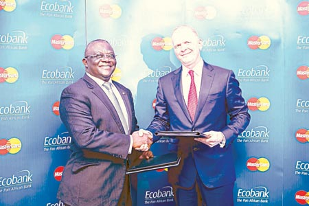 Group Chief Executive Officer, Ecobank Transnational Inc, Albert Essien (left); and President, Middle East and Africa, MasterCard, Michael Miebach, at the signing ceremony for landmark multi-country agreement  between Ecobank and MasterCard, to bring MasterCard's payment solutions to more than 32 sub-Saharan African markets, in Accra, Ghana, on Monday.