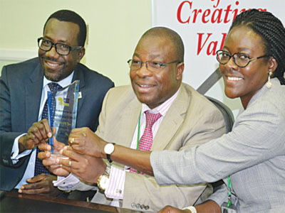 Managing Director, Mutual Benefits Assurance (General), Segun Omosehin (left); Group Managing Director, Dr. Akin Ogunbiyi; Head, Corporate Communication, Mrs. Ellen Offo, during the presentation of African insurers' innovative award to the company at a press briefing in Lagos PHOTO: GABRIEL IKHAHON