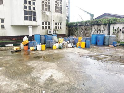 Drums of the lethal Ogogoro confiscated from various joints and distribution outlets in Bonny, (Inset: Vincent Kaakien, a victim in Bodo)