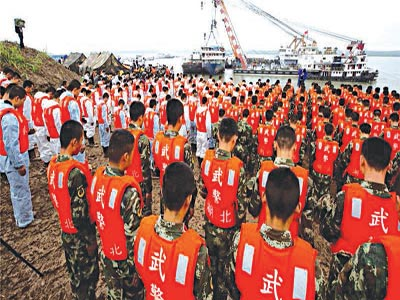 Rescue workers, soldiers and officials bowed their heads to honour the more than 430 people who died   PHOTO:AP