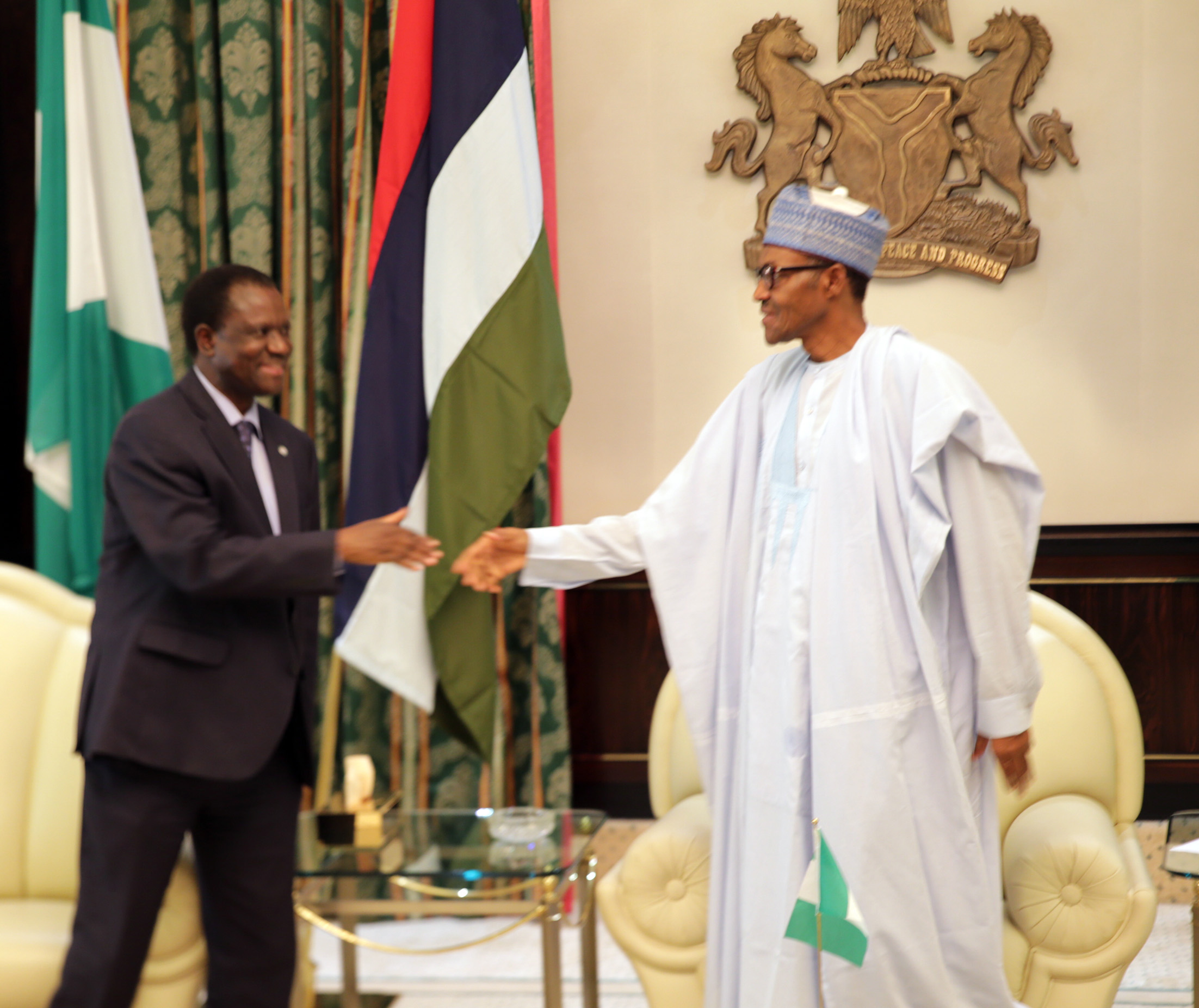 PRESIDENT BUHARI RECEIVES ECOWAS PRESIDENT 0A. President Muhammadu Buhari receives ECOWAS President Kare Desire Ouedraogo left at the Presidential Villa in Abuja. PHOTO; OFFICE OF THE PRESIDENT JUNE 25 2015.
