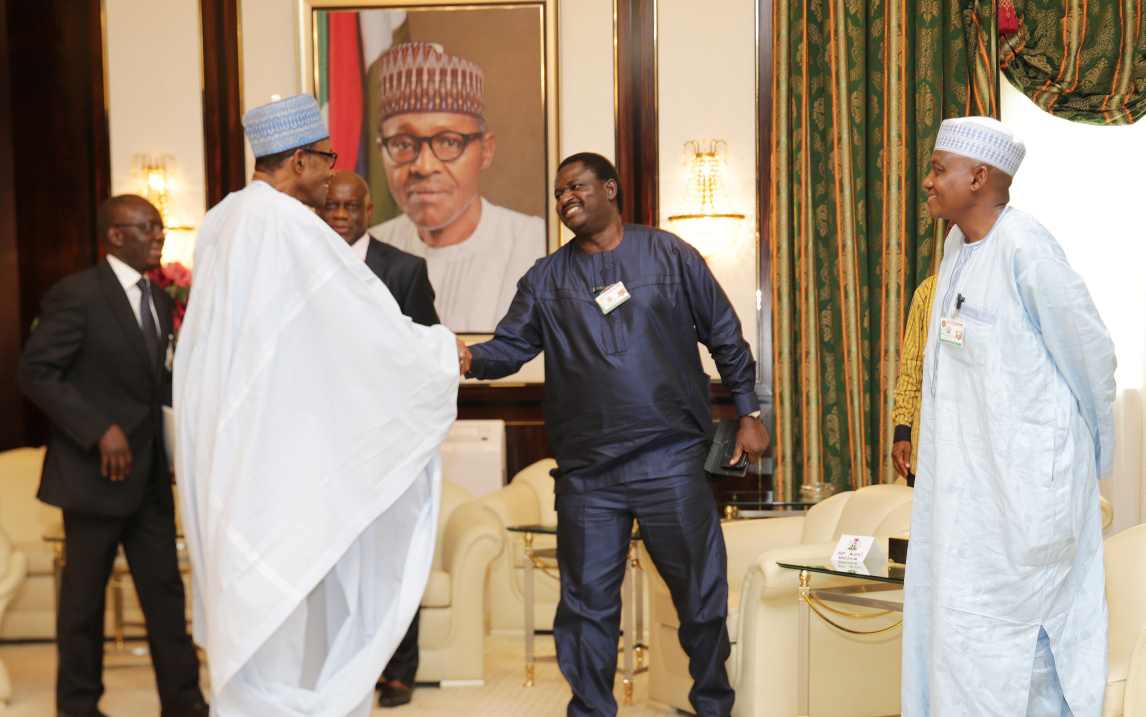 PRESIDENT BUHARI 5. President Muhammadu Buhari in a hand shake with his Senior Adviser on Media and Publicity, Mr Femi Adesina accompanied by Senior Special Assistant on Media and Publicity , Mallam Shehu Garba at the Presidential Villa in Abuja. PHOTO; OFFICE OF THE PRESIDENT JUNE 25 2015