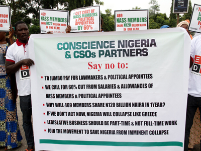 Protests against the salary and allowances of legislators in front of the National Assembly gate in Abuja today 23/06/15.Photo Ladidi Lucy Elukpo.