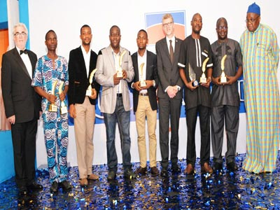 The winners in a group photograph with the Chairman of Panel of Judges and the Managing Director and Chairman of Promasidor Nigeria, at the event