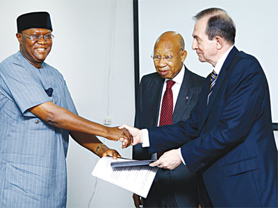 Prince Yemisi Adedoyin Shyllon (left); Pro-Chancellor of Pan-Atlantic University, Mr. Pascal G. Dozie and Vice Chancellor of Pan-Atlantic University,Prof. Juan M. Elegido receiving the donation from Shyllon
