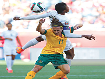 Super Falcons' Captain, Evelyn Nwabuoku (left) challenges Lisa De Vanna of Australia for a header during their second group match …on Friday.                PHOTO: GETTYIMAGES.