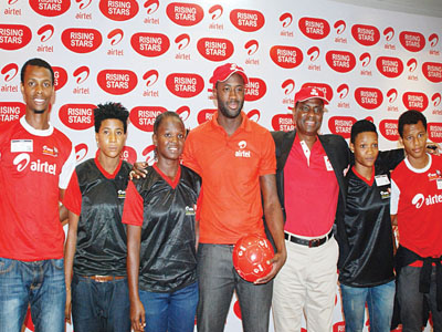 Products of the Airtel Rising Stars, Alhassan Ibrahim Abdullahi (left); Odueke Taibat, Unamba Augustina; Four Time African Footballer of The Year, Yaya Toure; Managing Director/Chief Executive Officer, Airtel, Segun Ogunsanya; Ikechukwu Vivian and Jacob Bala at the Launch of Airtel Rising Stars in Lagos… on Wednesday.                           PHOTO: FEMI ADEBESIN-KUTI