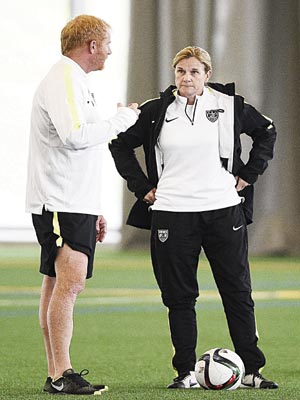 USA's head coach, Jill Ellis (right), speaks with a staff member during a training session in Montreal… on Sunday.