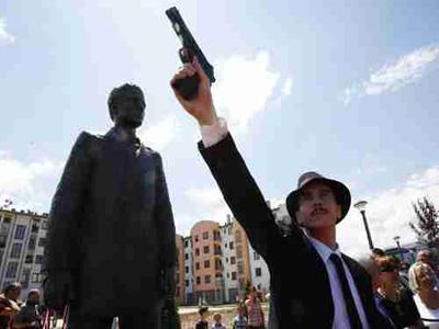 Bosnian actor Jovan Mojsilovic poses in front of monument honoring Gavrilo Princip at ceremony on Saturday (AP)