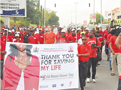 Advocates for voluntary blood donation marching on the streets of Abuja yesterday