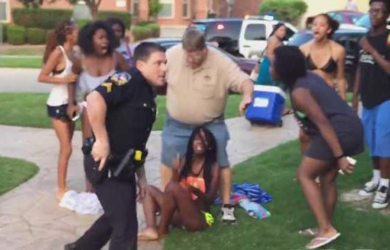 A Texas cop filmed pulling a gun at a pool party attended mainly by black teens. Photo: Perezhilton