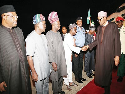 At Abuja airport: President Muhammadu Buhari (right); Inspector General of Police, Solomon Arase; a presidential aide, Mustapha Balarabe Shehu;  Governors Ibikunle Amosun and Samuel Ortom of Ogun and Benue states as well as others, during Buhari's arrival from African Union Summit in Johannesburg…yesterday                          PHOTO: PHILIP OJISUA