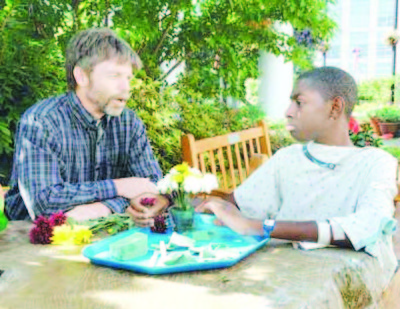 5. Plants help chldren , a horticultural therapy patient makes a fower arrangement Copy