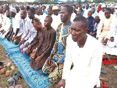 A cross-section of Muslims at a praying ground...