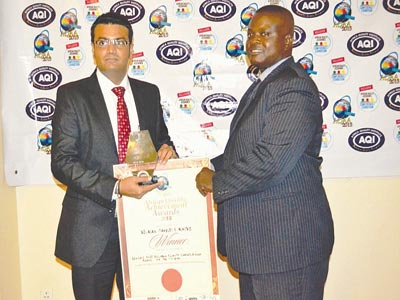 Legal Adviser Africa Quality Assurance Institute, Christian Akpotohwo (right) presenting the award  to General Manager, Lucky Fibres Plc. Mr. Jitesh Pamnani at the  event