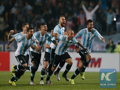 Argentina's players celebrate at the end of the Quarterfinals match of the Copa America Chile 2015, against Colombia, held in the El Sausalito Stadium, in Vina del Mar city, Chile, on June 26, 2015. (Xinhua/Jorge Villegas)
