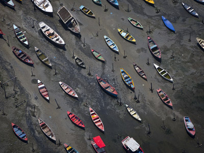 In this Nov. 19, 2013 file photo small boats sit on the shore of Guanabara Bay in the suburb of Sao Goncalo, across the bay from Rio de Janeiro, Brazil. Brazil will not make good on its commitment to clean up Rio de Janeiroís sewage-filled Guanabara Bay by the 2016 Olympic Games, state environmental officials acknowledged in a letter obtained Saturday May 17, 2014 by The Associated Press. (AP Photo/Felipe Dana, File)