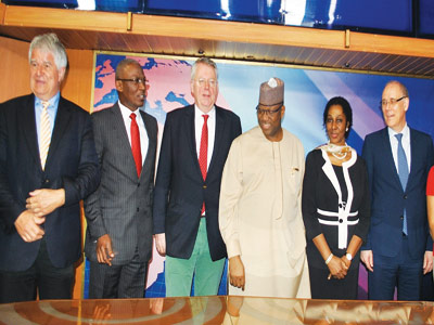 Director, International Relations, Deutsche Welle, Klaus Bergmann,(left);General Manager Operation,Channels Television, Kayode Akintemi, Director General, Deutsche Welle, Peter Limbourg, Chairman, Channels Television, John Momoh , his wife Sola and Consul General, Federal Republic of Germany, Michael Derus during the Channels Television with Deutsche Welle partnership media briefing in Lagos at the weekend.                   PHOTO:OSENI YUSUF.