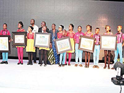 Child painters displaying their works