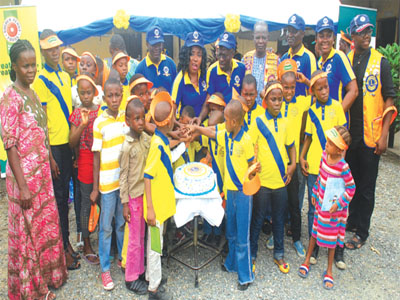 Members of the club with children of Yaba Motherless Babies' Home at the event