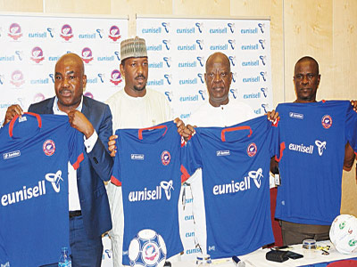 Group Managing Director, Eunisell, Chika Ikenga (left); Chairman, League Management, Company (LMC), Mallam Shehu Dikko; Former Chairman, LMC, Nduka Irabor; and General Manager, Sharks F.C, Okey Kpalukwu at the Eunisell Sharks Jersey unveiling in Lagos yesterday.