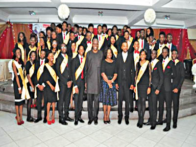 Edgewood College graduands with chairman of the school's board, Mr. Yemi Cardoso (middle), founder of the school, Mrs. Kehinde Philips; principal, Dr. Olayinka Oduwole, during the graduation ceremony in Lagos... recently