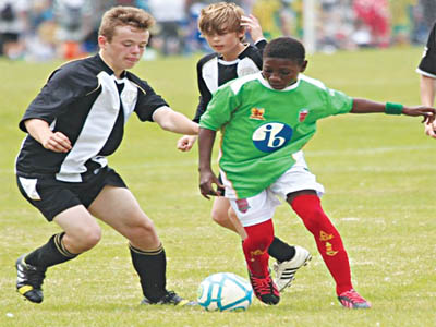 Greensprings' Musa Alli (right) takes on an opponent during the 2014 Warrior Keele Cup in Manchester. He will lead the school's team to the 2015 Nottingham International Cup in United Kingdom.