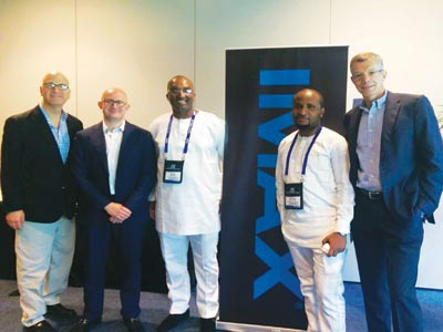 Managing Director of Film House Cinema and Film One Distribution Mr. 0Kene Mkparu (middle) and IMAX officials at the signing ceremony
