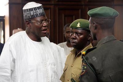 Former Governor of Jigawa State,Sule Lamido(left) disscussing with Security Personnels as he and his two sons were Charged to the federal high court for alledged Money Laundery in Abuja today 14/07/15.Photo Ladidi Lucy Elukpo.