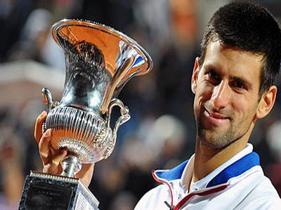 World number one, Novak Djokovic, hits a return to Roger Federer during their U.S Open final game… on Sunday. Djokovic won the game 6-4; 5-7; 6-4; 6-4 to win his second U.S Open title. PHOTO: AFP