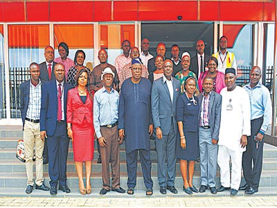 Managing director/CEO, SAHCOL, Dr. Olu Owolabi (5th left), chairman, Airfreight Stakeholders Forum, Toyin Olufade (5th right), with other members of the forum and SAHCOL management staff during the facility tour of the Forum at the company's ultra modern cargo warehouse at its headquarters, MMIA, Ikeja, Lagos…recently