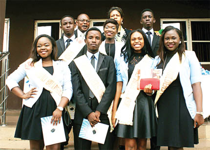A cross section of graduating students of Mind Builders School, Lagos with some officials during the school's 2015 valedictory and prize-giving ceremony