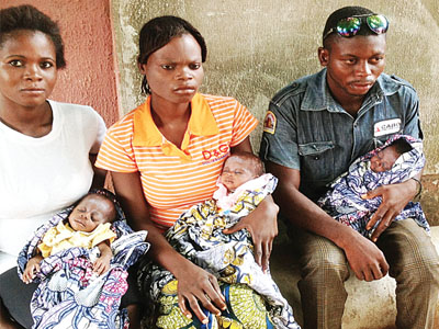 Mr.Terngu Gbaeren, his wife Mrs Iember Gbaeren and a relative with the babies
