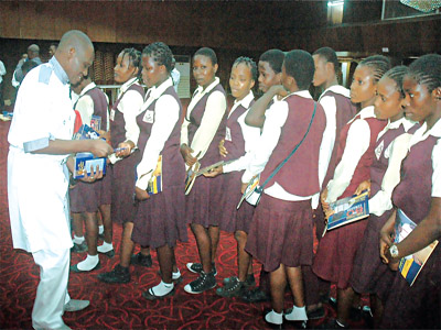 Uncle Fred Agbeyegbe distributing copies of his plays to secondary school students at the colloquium                                                 PHOTO: CHARLES OKOLO