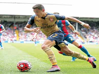 Alexis Sanchez scored one of Arsenal's goals against Crystal Palace…yesterday. PHOTO: AFP