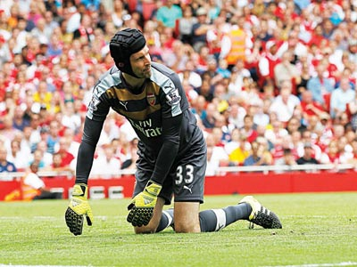 Arsenal goalkeeper, Petr Cech, looks on in despair after yet another goal by West Ham United at the Emirates… yesterday.     PHOTO: AFP