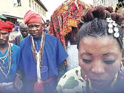 Osun Priest and Minder of Arugba, Chief Adigun Olayiwola Olosun and the Arugba on their way to Osun Grove in Osun State yesterday