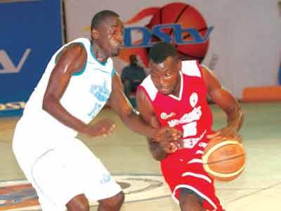Dodan Warriors' Romaric Quenum (right) battles Union Bank's Godfrey Moses during their DStv Premier Basketball League Final Eight playoff at the National Stadium, Lagos.