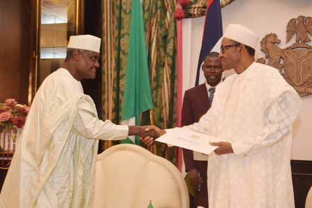 Chad's Minister of Foreign Affairs, Mr. Moussa Faki Mahamat, In a Handshake with President Muhammadu Buhari during his Visit to the President, at the Presidential Villa Abuja yesterday