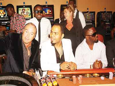 GM Federal Palace Hotel & Casino David Kliegl (left)Nollywood star Ramsey Noah, Chocolate City rapper Ice Prince (behind) with other guests during the Casino Celebrity Learner's Night.