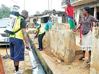 Community development: Members of Daystar Christian Church carring out their social responsibility by cleaning and fumigating streets, at Orile Agege in Lagos