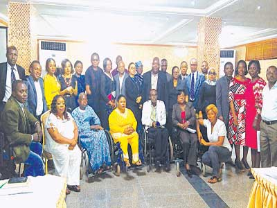 Legal adviser, Disability Advocacy policy Initiative (DPAI), Daniel Onwe, (standing 2nd fronm left); Dare Dairo of JONAPWD Lagos (sitting from left); Ms Pretty Ogbonna of DPAI; Obiora Ononugbo of Spinal Cord Injuries Association; Chioma Inyama; Olusola Adeyefa, National Secretary of Association for Comprehensive Empowerment of Nigerian with Disability (ASCEND), Sade Olafolake and others at the event.
