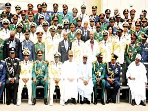 President Muhammadu Buhari (middle) with all the members of Course 23 after their graduation ceremony at the National Defence College in Abuja … yesterday.