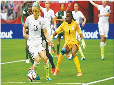 The Super Falcons battling with the U.S at the Canada 2015 Women World Cup.  The team failed to qualify for the Rio 2016 Olympic Games. 					                                      PHOT: FIFA