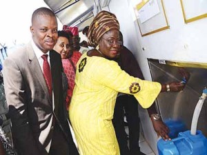 Deputy Governor, Ogun State, Mrs. Yetunde Onanuga (right) and Corporate Relations Director, Guinness Nigeria Plc, Mr. Sesan Sobowale, at the commissioning ceremony of a Water Health Centre donated by Guinness Nigeria to Adigbe Community in Abeokuta, Ogun State...recently.