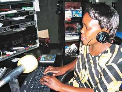 Female journalist … inside the studio of a radio station in Nairobi, Kenya