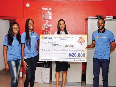 Head, PR and Brand Management,Olatomiwa Akande; Vice President, Marketplace Operations, Konga Amaka Odogwu; posing with Kechika Obianeli, Outlet Manager, Visafone and Chikodi Ukaiwe, Vice President, Marketplace Acquisition presenting Obianeli her N20,000 free shopping voucher/cheque as part of its Customer Appreciation Programme to mark its 3rd anniversary in Lagos.