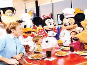 A family entertained by Chef Mickey Character at a dinner in Orlando.