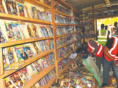 NCC officials raiding a shop in Asata, Enugu at the weekend